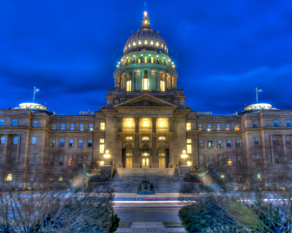 "<h3 style=""text-align: left;""><strong>Today's Photo:  Idaho's Liberty Bell</strong></h3> Sitting in front of the Idaho state capitol is a replica of the Liberty Bell.  I stood across the street, in front of the statue of Governor Frank Steunenberg to take this shot.  There is a pathway with several large bushes lining it.  Because the wind was so bad, the bushes just whipped around and made an eerie shadow of the bushes across the front of the capitol.  - Daryl Clark  Read more at the <a href=""http://justshootingmemories.com"">Daily Photography Blog</a> Just Shooting Memories!..."
