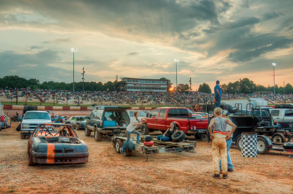 """<h3 style=""""text-align: left;""""><strong>Today's Photo:  Dixie Speedway</strong></h3> I was shooting in the pits at Dixie Speedway when I noticed several people take a minute to watch as the sun was setting.  There was an electric feel to the air as everyone was getting ready for some racing under the lights.  The grandstands were filling and fine tuning was happening to some engines.  Nothing like the smell of gas, loud engines and Georgia red clay to make for the start of a good Saturday night.  - Daryl Clark  Read more at the <a href=""""http://justshootingmemories.com"""">Daily Photography Blog</a> Just Shooting Memories!..."""