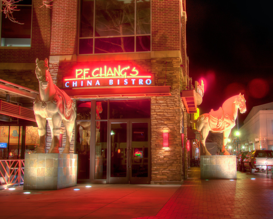 "<h3 style=""text-align: left;""><strong>Today's Photo:  Standing Guard</strong></h3> I ran across this P.F. Chang's in downtown Boise.  I was near the end of my walk and turned the corner to see this.  With all the red lights, I thought it looked rather cozy or like a call to arms.  I almost stopped for a bite to eat.  I'm glad I did not because I got a few more shots after this.  However, if you ever run across a P.F. Chang's and have time to stop, the food is amazing.  - Daryl Clark  Read more at the <a href=""http://justshootingmemories.com"" rel=""nofollow"">Daily Photography Blog</a> Just Shooting Memories!..."