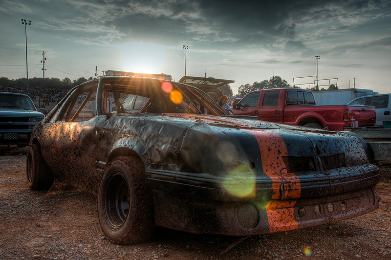 """<h3><strong>Today's Photo:  In the Dirt at Dixie</strong></h3> Shooting at a dirt race track was tons of fun and challenging.  The lighting is terrible, it is horribly loud and there is the ever present dirt.  Fortunately, I got a pit pass, but it was only for me and not the rest of the family or my van.  Nothing leaves a dirt track clean and that included my camera gear.  Most of the time, I stood on the back of a four wheeler in turn two and got some good action shots.  That was until one car hit the inside wall just beside me.  I missed most of the mud, but not the camera.  - Daryl Clark  Read more at the <a href=""""http://justshootingmemories.com"""" rel=""""nofollow"""">Daily Photography Blog</a> Just Shooting Memories!..."""