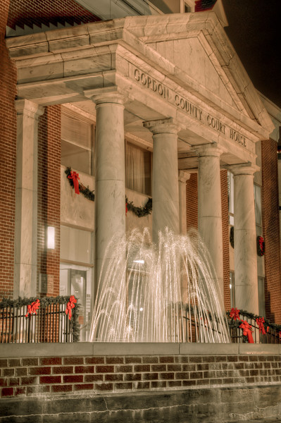 """<h3 style=""""text-align: left;""""><strong>Today's Photo: Christmas in Calhoun</strong></h3> It is too bad that Christmas lights are only up for about a month.  I wanted to visit so many more places, but did not have the time.  This is the county courthouse in Gordon County.  I decided to shoot the Christmas lights in downtown and invited my sister.  We were walking around the courthouse when she showed me a photo she had taken.  I thought it was so good, that I had to go back and steal that composition... This is it."""