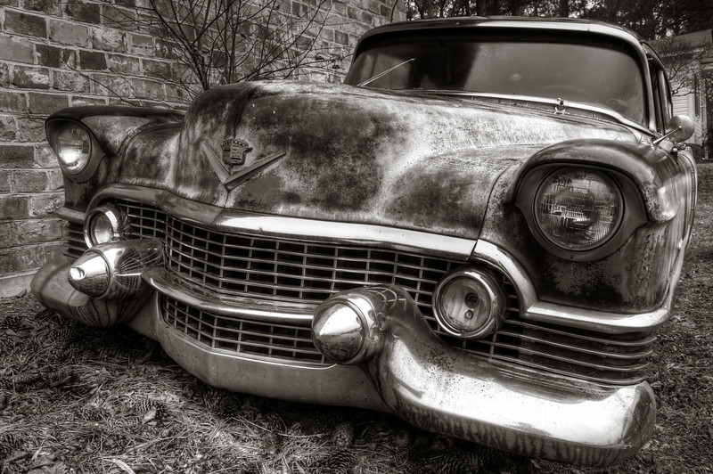 """<h3 style=""""text-align: left;""""><strong>Today's Photo: The First Caddy</strong></h3> It does not take long to run into good photographic opportunities at Old Car City in White Georgia.  Sitting just outside the front door is this old Cadillac.  It is the first of many old junk cars that you will find while exploring the miles of lanes lined with old junk cars."""