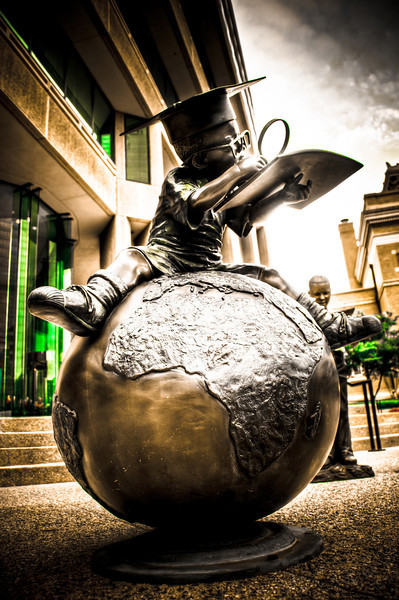 """<h3 style=""""text-align: left;""""><strong>Today's Photo: On Top of the World</strong></h3> This statue is in front of the Boys and Girls Club of America headquarters on Peachtree Street in Atlanta.  I was having tons of fun taking photos around this area and ran across this one.  I had to wait a couple minutes for my turn, but I think it was worth it.  This status is only a few feet tall, so I had to lay down to get this angle.  I got a few odd looks for it.  It's all in a days work.  Visual proof that if you work hard there is no limit to what you can do.  Even making it on top of the world.  - Daryl Clark  Read more at the <a href=""""http://justshootingmemories.com"""">Daily Photography Blog</a> Just Shooting Memories!..."""