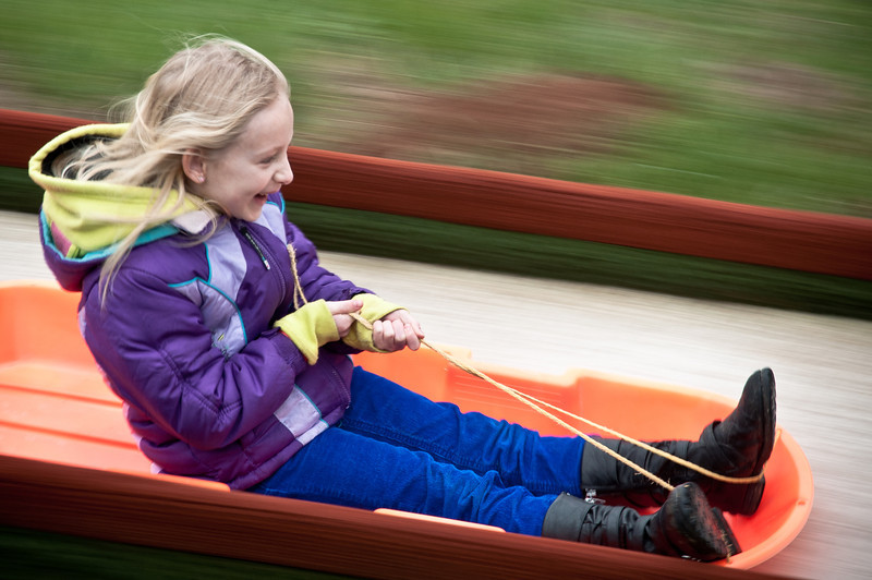 <h3><strong>Today's Photo: Sledding Time</strong></h3> I used to not take my camera when I go to events with my children.  Now I do but I get so tied up in what is going on, that I don't take too many photos.  My daughter went to a birthday party where they have a year round downhill tubing slope.  I am glad that I decided to break out the camera for this.  I got some great smiles and joy captured.  This was one of many.
