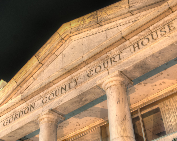 """<h3 style=""""text-align: left;""""><strong>Today's Photo:  Gordon County Court House</strong></h3> Most county court houses have been around for a while.  Some are architecturally more pleasing than others.  In 1961, Gordon county built its current court house.  I took this shot while taking Christmas light photos in downtown one night.  - Daryl Clark  Read more at the <a href=""""http://justshootingmemories.com"""" rel=""""nofollow"""">Daily Photography Blog</a> Just Shooting Memories!..."""