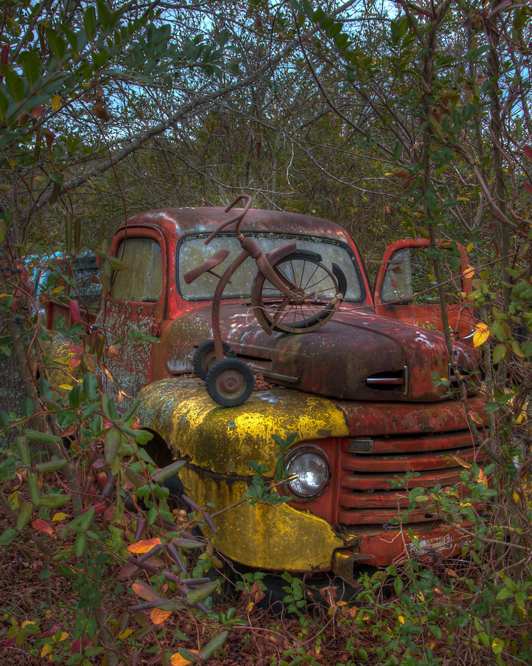 """<h3 style=""""text-align: left;""""><strong>Today's Photo:  Red Rum</strong></h3> I am not afraid of many things and watching horror movies does not bother me.  Well, with the exception of one, The Shining with Jack Nicholson.  When I saw this truck with the tricycle sitting on it, all I could do was think of the Shining and Danny riding his tricycle through the halls.  I had to look over my shoulder a couple times to make sure no one was creeping up on me.  - Daryl Clark  Read more at the <a href=""""http://justshootingmemories.com"""" rel=""""nofollow"""">Daily Photography Blog</a> Just Shooting Memories!..."""