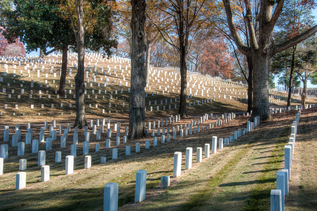 """<h3 style=""""text-align: left;""""><strong>Today's Photo: Marietta National Cemetery</strong></h3> Just outside the heart of downtown Marietta Georgia is a single knoll surrounded by chest high walls.  It is a quiet place among the bustle of a modern 21st century town.  On top of the knoll is a flag, a rostrum and a memorial to those who have fought and died for the sake of freedom.  Looking from outside the cemetery, you see row upon row of headstones lined up around the hill in orderly fashion.  - Daryl Clark  Read more at the <a href=""""http://justshootingmemories.com"""">Daily Photography Blog</a> Just Shooting Memories!..."""