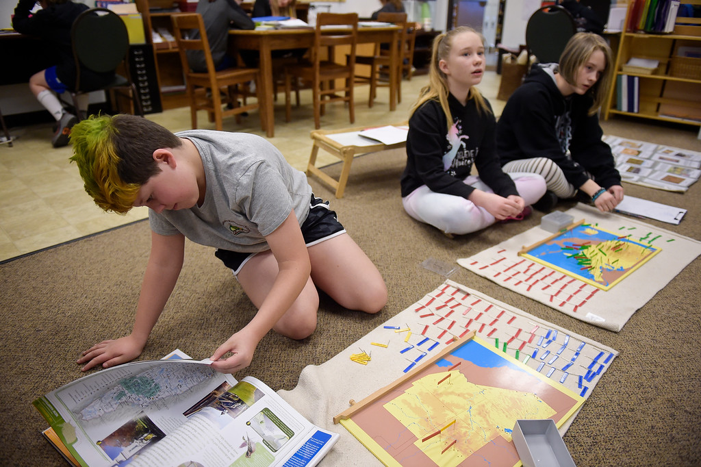 . LONGMONT, CO - MARCH 21: From left: Ella Davis, Mackenzie Carr and Zoe Unland work on pin maps in the upper elementary building at St. Vrain Community Montessori March 21, 2019. To view more photos visit timescall.com. (Photo by Lewis Geyer/Staff Photographer)