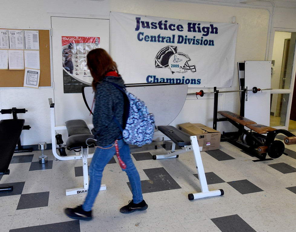 . LAFAYETTE, CO - APRIL 2:Tatum Heckman walks through the weight room that also serves as a dining area. Justice High is hoping to win a competitive state grant to renovate its aging building and hoping Boulder Valley School District will provide matching funds.  (Photo by Cliff Grassmick/Staff Photographer)