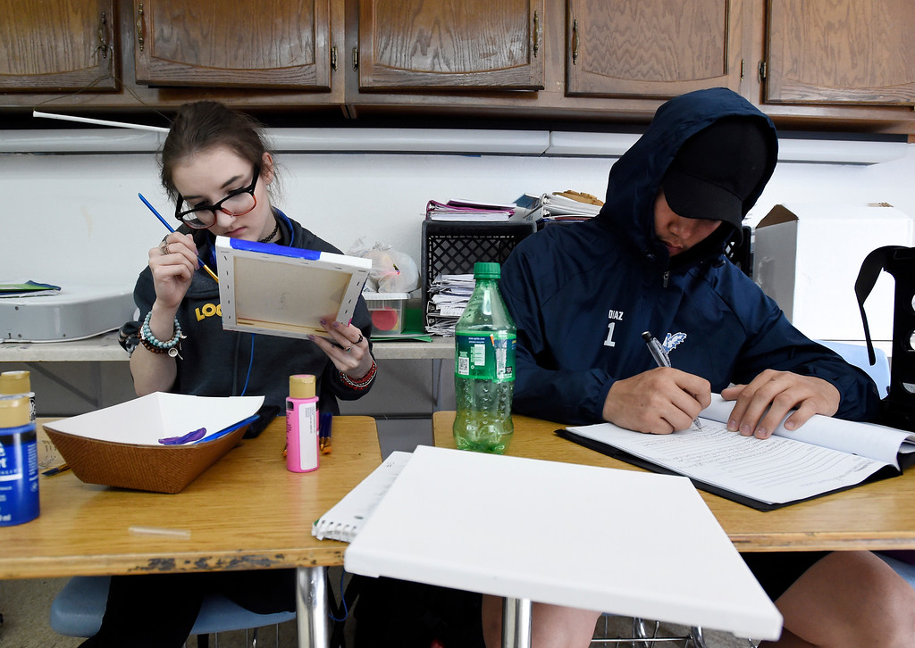 . LAFAYETTE, CO - APRIL 2: Brittany Geisler, left and Mario Diaz, work on projects in class in this multi-purpose room on April 2, 2019. Justice High is hoping to win a competitive state grant to renovate its aging building and hoping Boulder Valley School District will provide matching funds.  (Photo by Cliff Grassmick/Staff Photographer)
