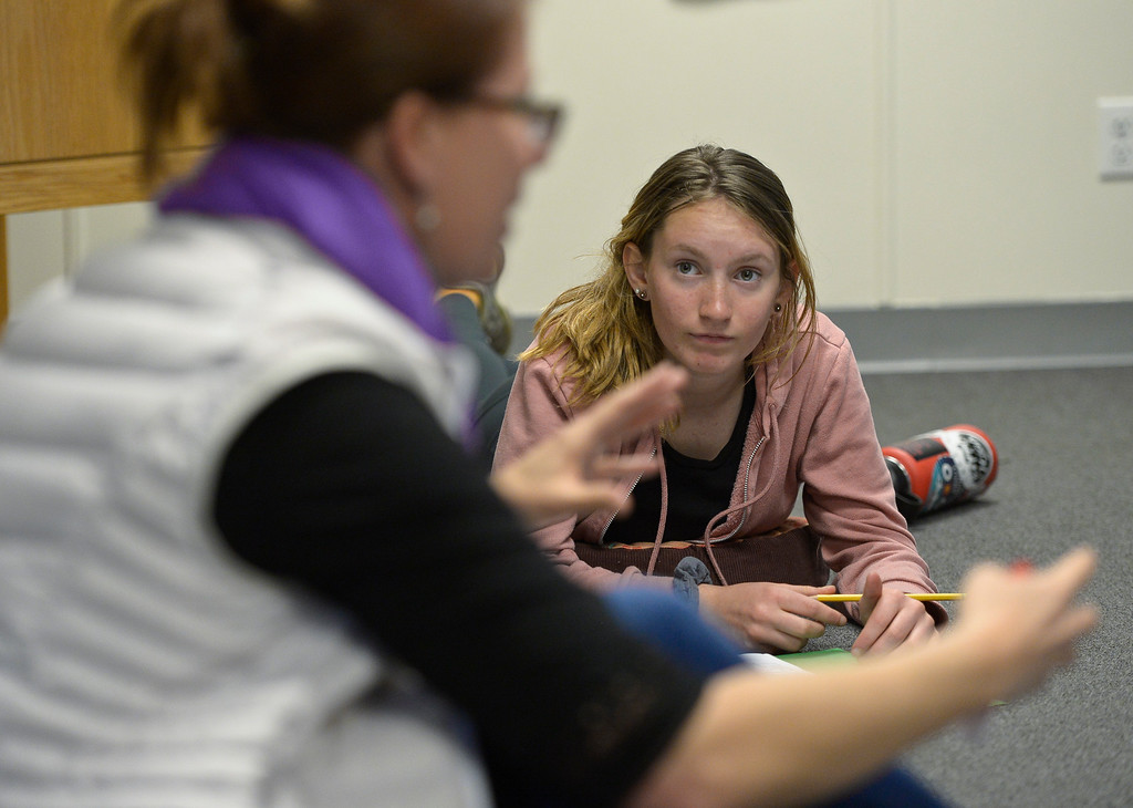 . LONGMONT, CO - MARCH 21: Student Uma Champe, right, listens to guide Amanda Stone Norton teach a poetry and ecology class in a modular building at St. Vrain Community Montessori March 21, 2019. To view more photos visit timescall.com. (Photo by Lewis Geyer/Staff Photographer)