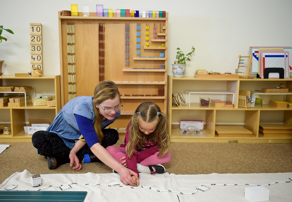 . LONGMONT, CO - MARCH 21: Guide Anna Vernier works with student Zaria Jones in the Lower Elementary building at St. Vrain Community Montessori March 21, 2019. To view more photos visit timescall.com. (Photo by Lewis Geyer/Staff Photographer)