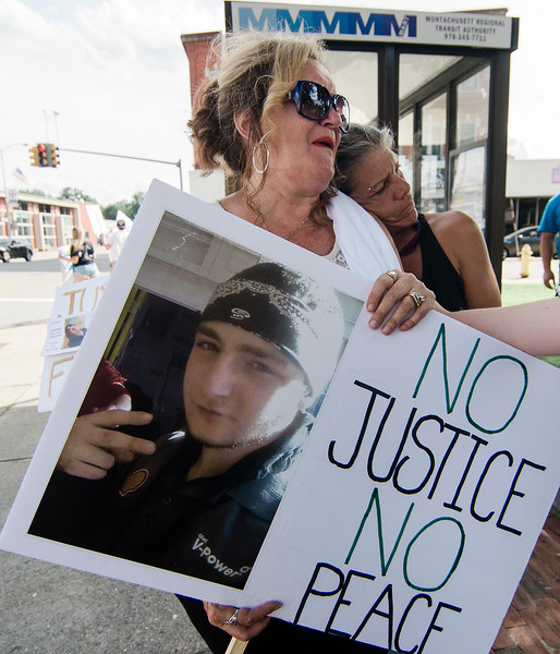 Tracy Marrama comforts Marie Fortuna, the mother of Frankie Fortuna, as she holds a sign during a rally urging justice for the death of her son, who was just 19-years-old when he was killed in a hit-and-run on November 17, 2016. SENTINEL & ENTERPRISE / Ashley Green