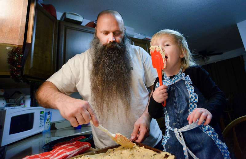 "Justin Sheely | The Sheridan Press<br /> Pat Tarver and his daughter Ashlynn, 3, spread cookie dough in their home kitchen. Tarver is a single father. ""Remember to breathe, you're going to get stressed out,"" Tarver said. ""It's not going to do anything to lose your cool."" But, Tarver says, everyone is going to lose their cool. Read the story: <a href=""http://thesheridanpress.com/homegrown-stepping-up/"">http://thesheridanpress.com/homegrown-stepping-up/</a>"
