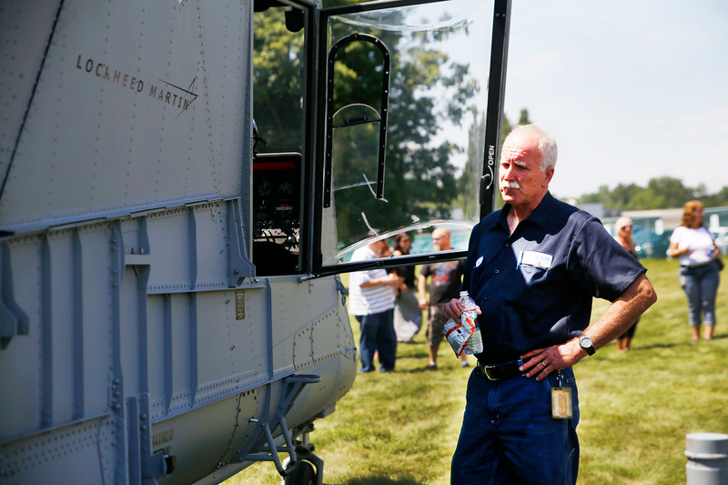 HOLLY PELCZYNSKI - BENNINGTON BANNER Joel Peckham, a Kaman composite worker of 29 years checks out the small interior of the KMAX helicopter after it made a landing at the company picnic.
