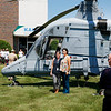 Mardi Sargent, a program coordinator of twenty four years at Kaman stands along her co-worker  Denise Stroffoleno a Contract Administrator of seven years as they are photographed in front of the K-MAX helicopter.