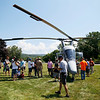 HOLLY PELCZYNSKI - BENNINGTON BANNER Workers and their families walk around a K-MAX helicopter during their annual employee picnic .
