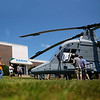 Workers and their families take a closer peek at a K-MAX helicopter after it lands in the front yard of the factory during the Kaman company picnic. Roads were temporarily closed during the landing of the helicopter.