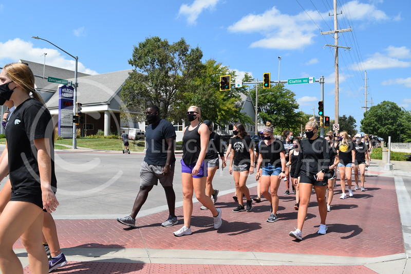 K-State athletes cross the intersection of Claflin Rd. and Denison Ave. during the K-State Athletics Walk Against Injustice on August 30, 2020. (Cameron Bradley | Collegian Media Group)