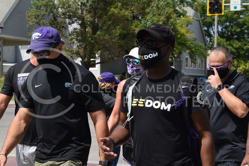 Julian Jones, Assistant AD for Student-Athlete Development/Chief Diversity Officer, marches with athletes during the K-State Athletics Walk Against Injustice on August 30, 2020. (Cameron Bradley | Collegian Media Group)
