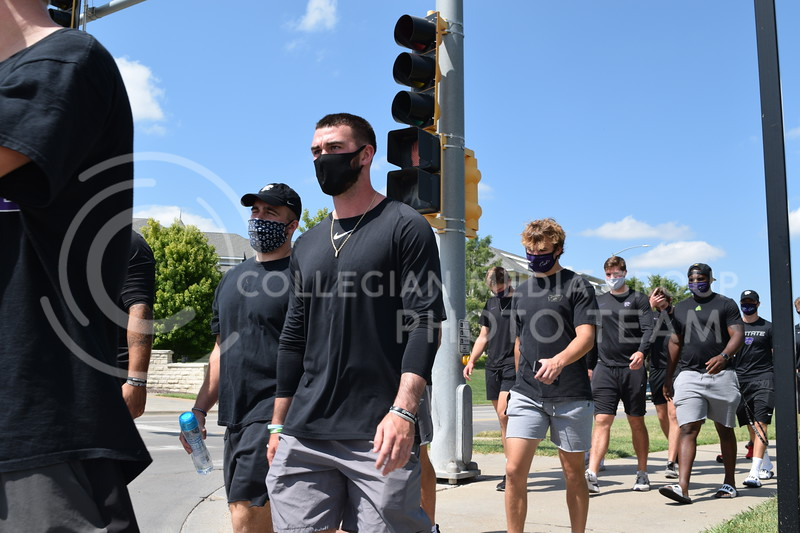 K-State quarterback Skylar Thompson  <br /> walks with athletes during the K-State Athletics Walk Against Injustice on August 30, 2020. (Cameron Bradley | Collegian Media Group)