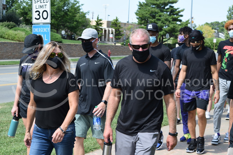 K-State head football coach Chris Klieman  walks with athletes during the K-State Athletics Walk Against Injustice on August 30, 2020. (Cameron Bradley | Collegian Media Group)