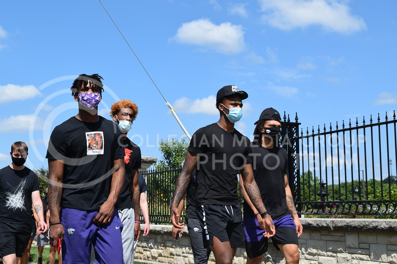 K-State Men's Basketball players march during the K-State Athletics Walk Against Injustice on August 30, 2020. (Cameron Bradley | Collegian Media Group)