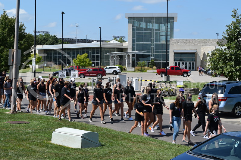 Athletes walk across the Jardine Apartment parking lot while protesting during the K-State Athletics Walk Against Injustice. August 30, 2020. (Cameron Bradley | Collegian Media Group)