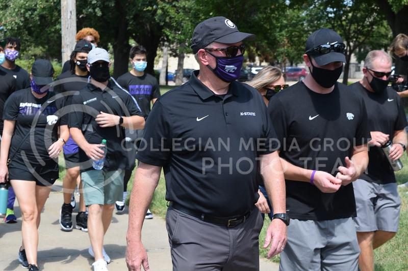 K-State Athletic Director Gene Taylor  walks with athletes during the K-State Athletics Walk Against Injustice on August 30, 2020. (Cameron Bradley | Collegian Media Group)