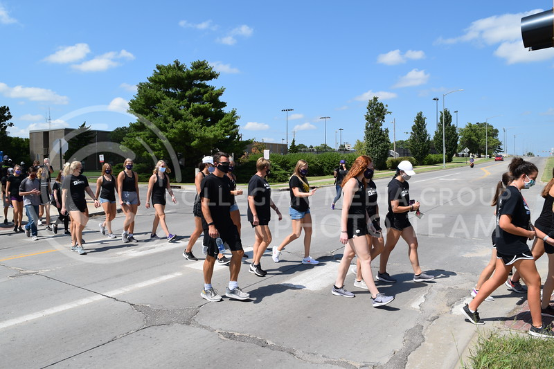 Athletes walk across Denison Ave. while protesting during the K-State Athletics Walk Against Injustice. August 30, 2020. (Cameron Bradley | Collegian Media Group)