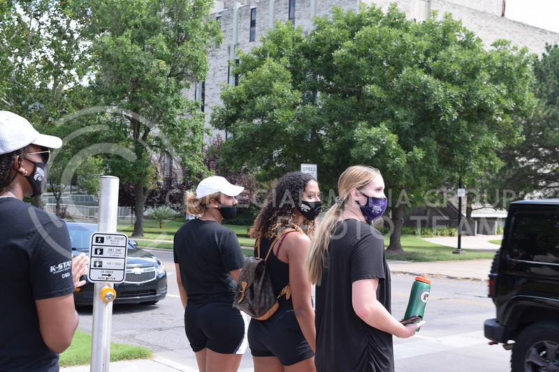 K-State Women's Basketball players wait to cross the intersection of Claflin Rd. and Denison Ave. during the K-State Athletics Walk Against Injustice on August 30, 2020.  (Cameron Bradley | Collegian Media Group)