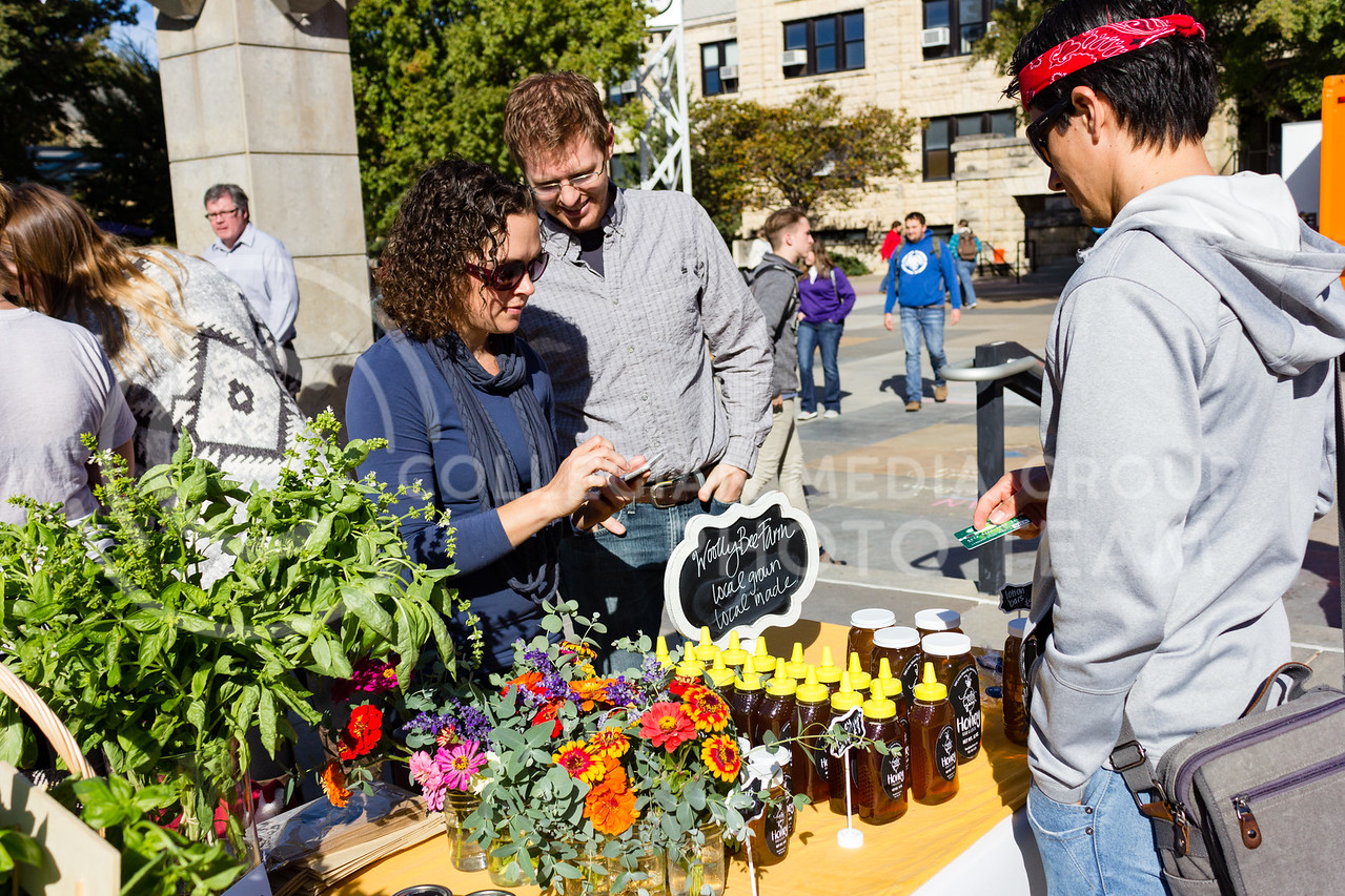 Jen and Matt Campbell sell goods from Wooley Bee Farm at the K-State Farmers Market on 25th October, 2017 (Alex Shaw | Collegian Media Group)