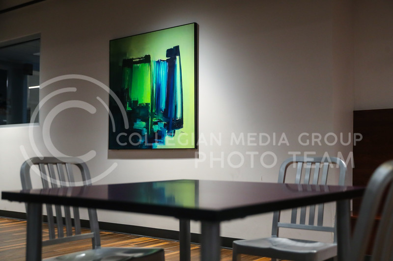 Modern abstract art accents the walls of the renovated student union. (Photo by Cooper Kinley | Collegian Media Group)