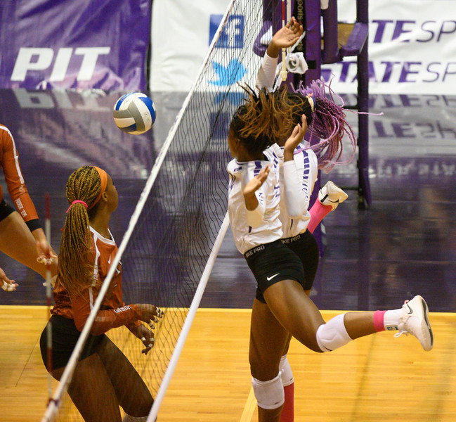 Defenders Megan Vernon and Gloria Mutiri block a spike during the K-State vs Texas volleyball match. During Cats for a Cure night, Texas defeated the Wildcats 0-3. Oct 10, 2019. (Dylan Connell | Collegian Media Group)
