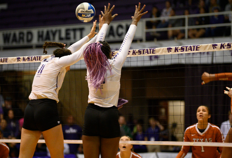 Blocker, Peyton Williams and Gloria Mutiri, attempt a block Vs Texas. During Cats for a Cure night, Texas defeated the Wildcats 0-3. Oct 10, 2019. (Dylan Connell | Collegian Media Group)