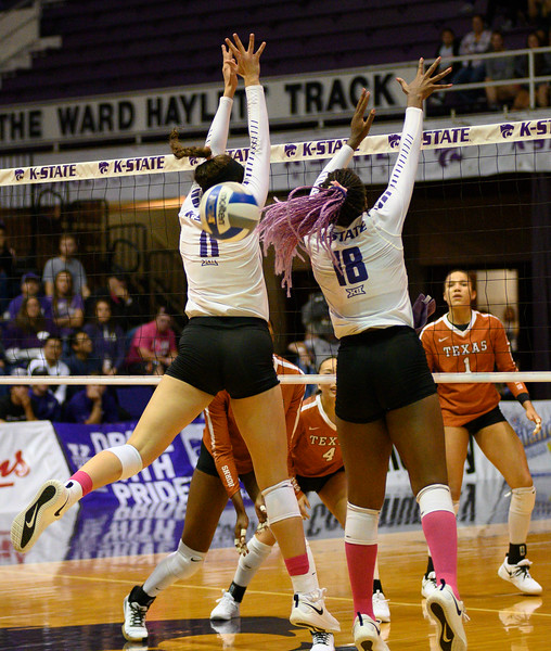 Blocker, Peyton Williams and Gloria Mutiri, attempt a block Vs Texas, but come up short. During Cats for a Cure night, Texas defeated the Wildcats 0-3. Oct 10, 2019. (Dylan Connell | Collegian Media Group)