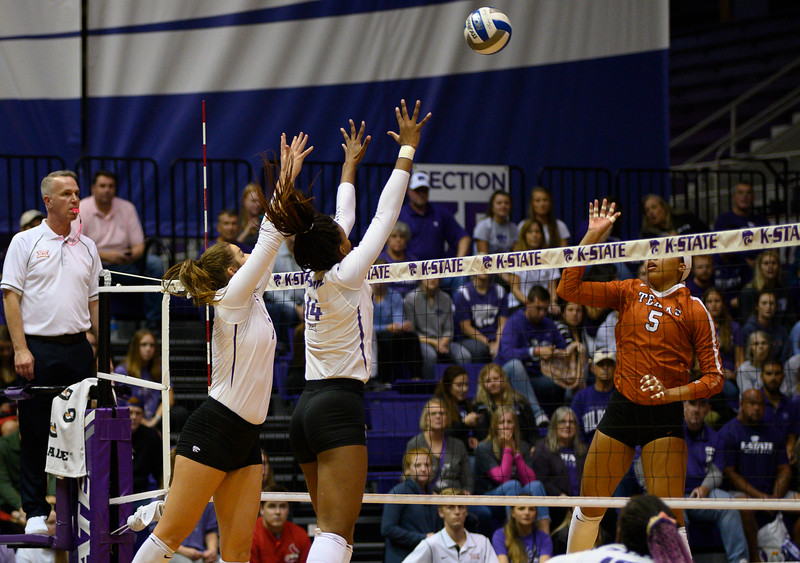 Defenders Megan Vernon and Anna Dixon attempt to block Texas attacker, Skylar Fields. During Cats for a Cure night, Texas defeated the Wildcats 0-3. Oct 10, 2019. (Dylan Connell | Collegian Media Group)