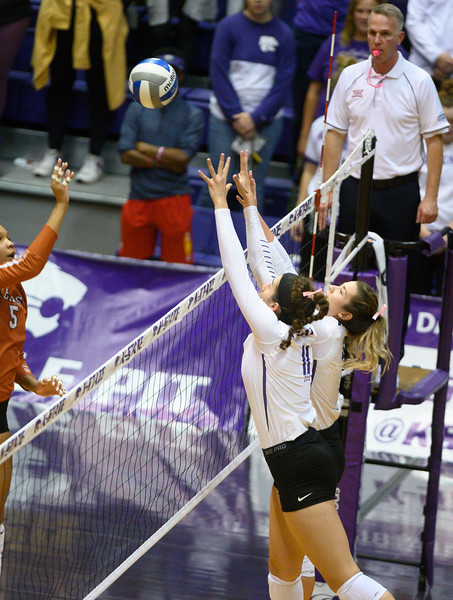 Blocker, Peyton Williams and  Setter,<br /> Sarah Dixon, attempt a block Vs Texas. During Cats for a Cure night, Texas defeated the Wildcats 0-3. Oct 10, 2019. (Dylan Connell | Collegian Media Group)