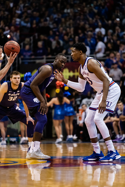 Kansas State Wildcat junior forward Makol Mawien prepares to compete in the tip-off against Kansas Jayhawk freshman forward David McCormack winning the ball in favor of K-State. The Kansas State Wildcats played against the Kansas Jayhawks at Allen Fieldhouse on Monday Feb. 26, 2019 losing 64-49. (Olivia Bergmeier | Collegian Media Group)