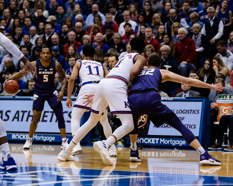 Kansas State Wildcat senior forward Dean Wade fights to get open near the paint against Kansas Jayhawk junior forward Dedric Lawson. The Kansas State Wildcats played against the Kansas Jayhawks at Allen Fieldhouse on Monday Feb. 26, 2019 losing 64-49. (Olivia Bergmeier | Collegian Media Group)