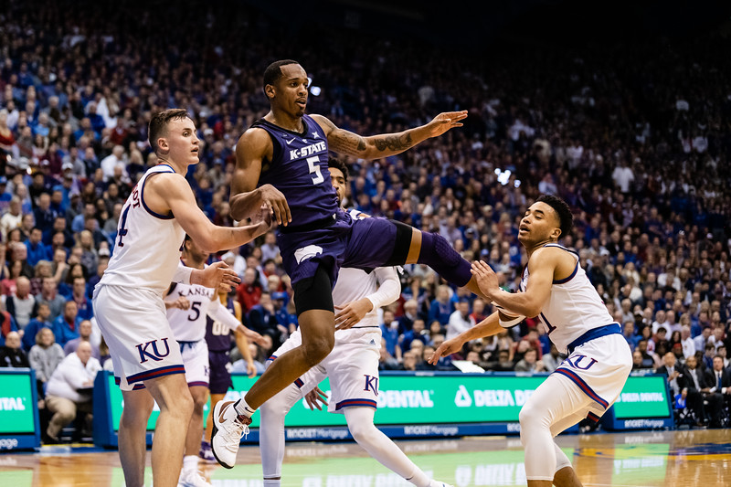 K-State Wildcat senior guard Barry Brown Jr. passes the ball while jumping. The Kansas State Wildcats played against the Kansas Jayhawks at Allen Fieldhouse on Monday Feb. 26, 2019 losing 64-49. (Olivia Bergmeier | Collegian Media Group)