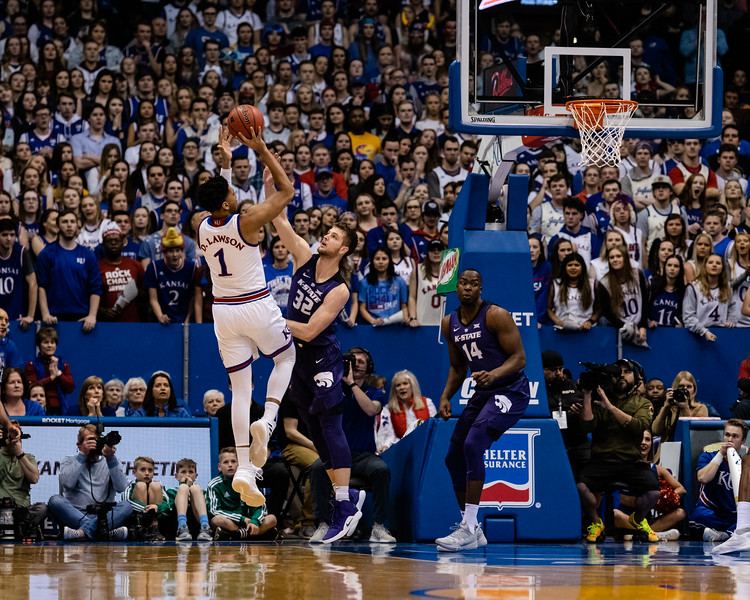Kansas State Wildcat senior forward Dean Wade attempts to block Jayhawk junior forward Dedric Lawson as he shoots the ball to score two for Kansas. The Kansas State Wildcats played against the Kansas Jayhawks at Allen Fieldhouse on Monday Feb. 26, 2019 losing 64-49. (Olivia Bergmeier | Collegian Media Group)