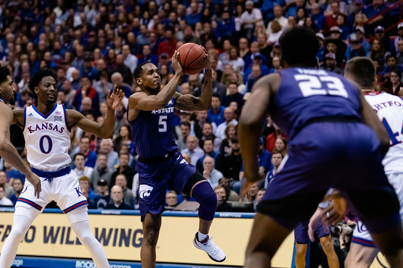K-State wildcat senior gaurd Barry Brown Jr. shoots a layup in attempt to score against the Kansas Jayhawks. The Kansas State Wildcats played against the Kansas Jayhawks at Allen Fieldhouse on Monday Feb. 26, 2019 losing 64-49. (Olivia Bergmeier | Collegian Media Group)