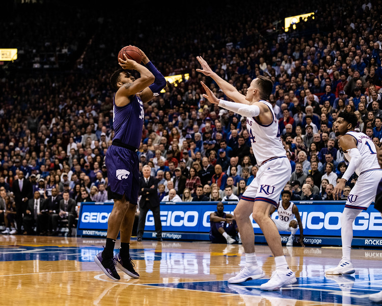 K-State Wildcat sophomore forward Levi Stockard III shoots for two against Jayhawk junior forward Mitch Lightfoot. The Kansas State Wildcats played against the Kansas Jayhawks at Allen Fieldhouse on Monday Feb. 26, 2019 losing 64-49. (Olivia Bergmeier | Collegian Media Group)