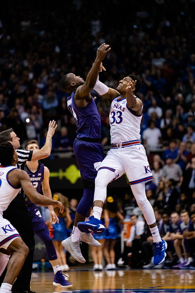 K-State wildcat junior forward Makol Mawien jumps against Kansas freshman forward David McCormack, winning the ball in favor of the Wildcats. The Kansas State Wildcats played against the Kansas Jayhawks at Allen Fieldhouse on Monday Feb. 26, 2019 losing 64-49. (Olivia Bergmeier | Collegian Media Group)