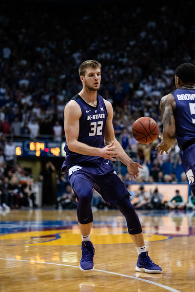 K-State Wildcat senior forward Dean Wade passes the ball to fellow senior guard Barry Brown Jr. while running an especially quick play. The Kansas State Wildcats played against the Kansas Jayhawks at Allen Fieldhouse on Monday Feb. 26, 2019 losing 64-49. (Olivia Bergmeier | Collegian Media Group)