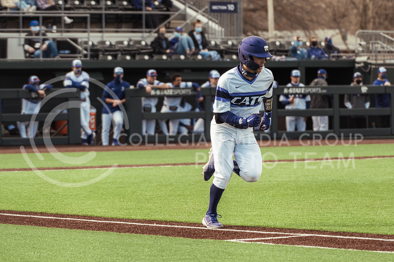 K-State starter, Cameron Thompson, runs to first base after a hit. Thompson landed a three-run home run later on in the match. This moved Cameron to a ninth-place tie on K-State's all-time hit list at 219 base hits. K-State took the series with an 11-3 Win over WMU at Tointon Family Stadium on Feb 27, 2021. (Dylan Connell | Collegian Media Group)