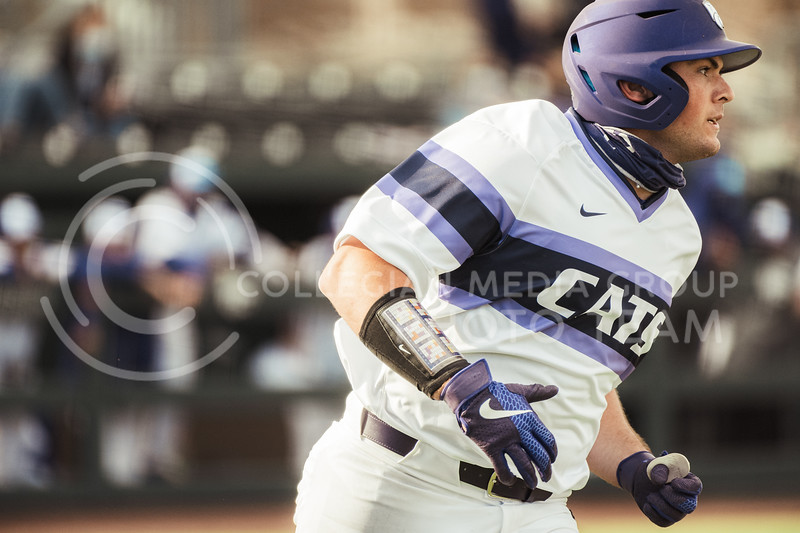 K-State starter,  Dylan Phillips, runs to first after an RBI, Philips ended the day with two hits. K-State scored 11 runs on 14 hits with one error and nine left on base. K-State took the series with an 11-3 Win over WMU at Tointon Family Stadium on Feb 27, 2021. (Dylan Connell | Collegian Media Group)