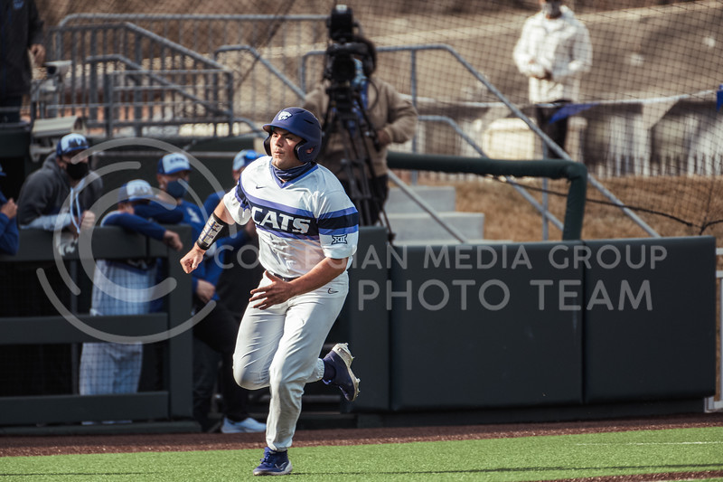 K-State starter,  Dylan Phillips, runs to home base, Philips ended the day with two hits. K-State scored 11 runs on 14 hits with one error and nine left on base. K-State took the series with an 11-3 Win over WMU at Tointon Family Stadium on Feb 27, 2021. (Dylan Connell | Collegian Media Group)