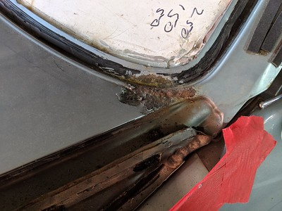 Rust in screen surround has spread under the paint down to the wing and door area